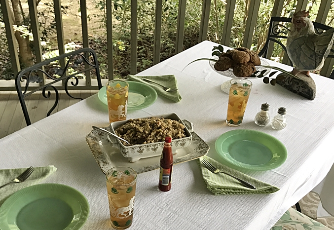 Table setting with Jadite Dishes, Cabbage Dressing, Sweet Tea and LA Hot Sauce www.diningwithmimi.com