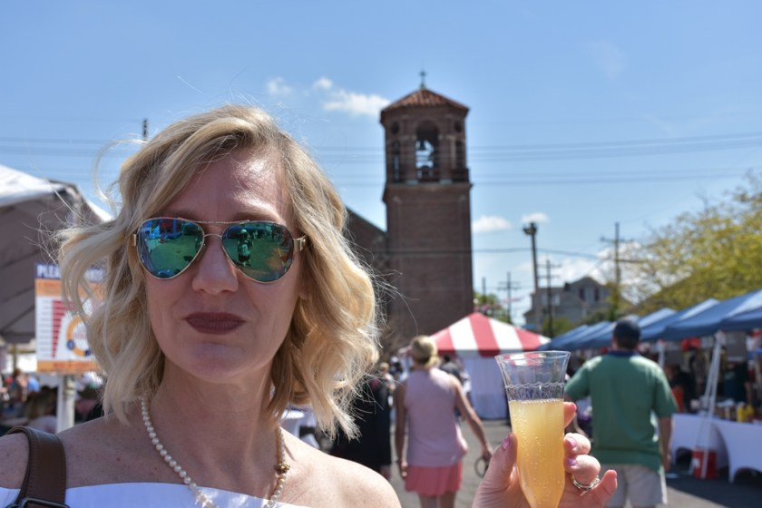 Pretty blond holding mimiosa at Fete Francaise Need a quickie- Drop into New Orleans for 48 hours www.diningwithmimi.com