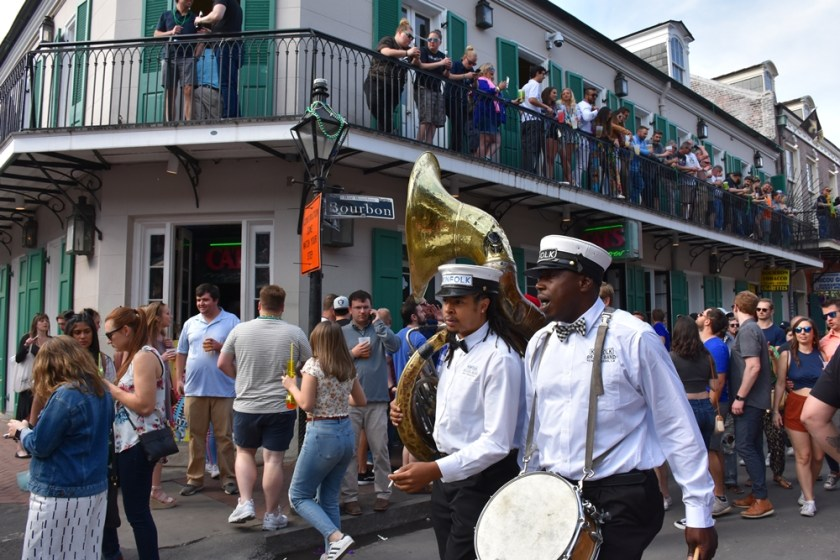 Bourbon St street scene people and Brass Band Need a quickie- Drop into New Orleans for 48 hours www.diningwithmimi.com