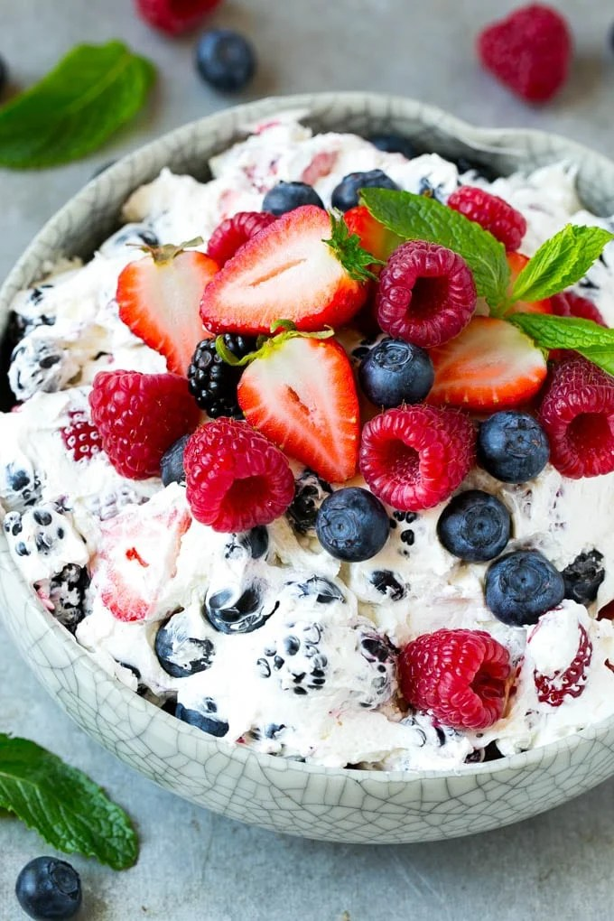 This berry cheesecake salad recipe is a variety of fresh berries tossed in a light and creamy cheesecake mixture. The perfect summer salad!