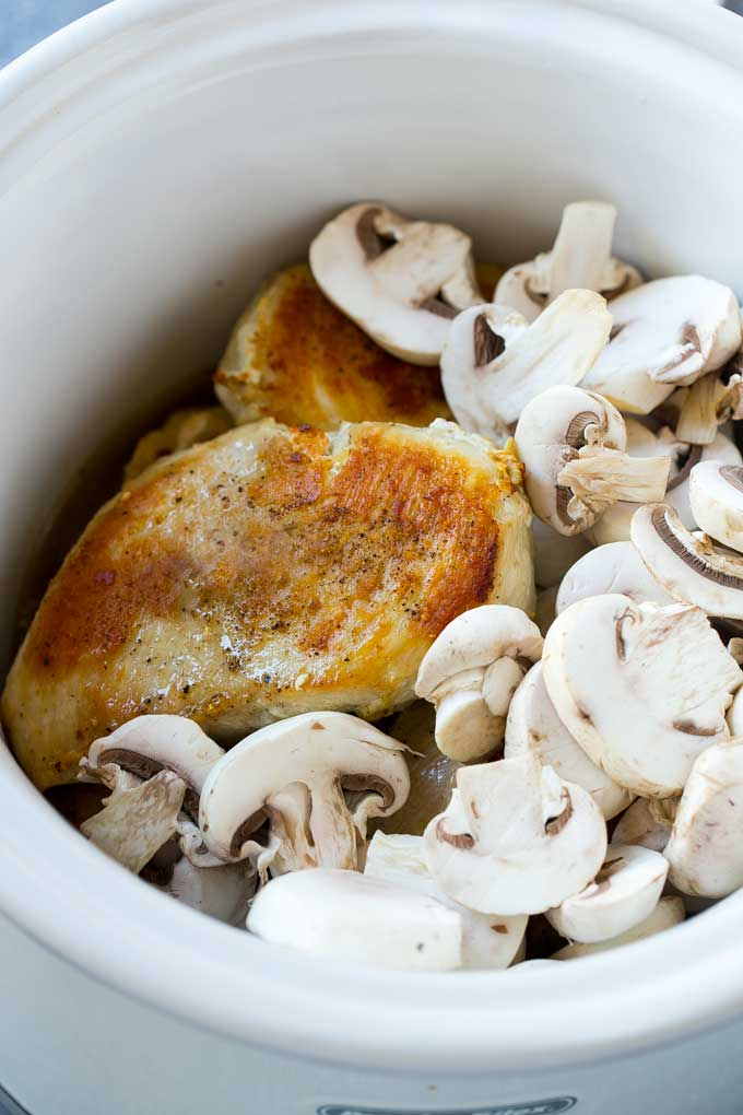 Chicken breasts and mushrooms in a slow cooker are the basis of crock pot chicken marsala.