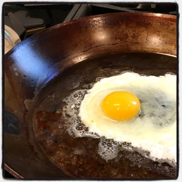 carbon steel pan with egg