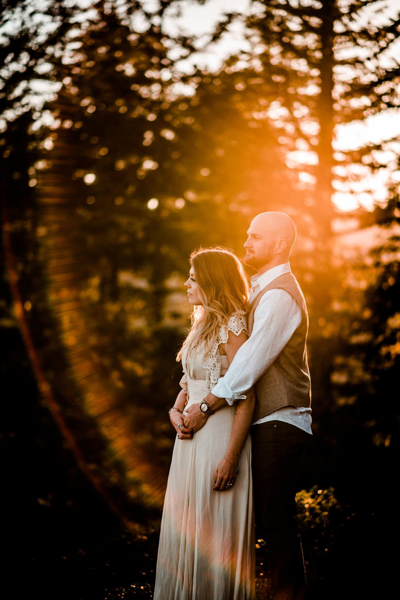 Engaged couple portraits during golden hour in the forest at Detroit Lake, Oregon