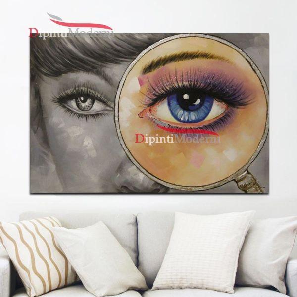 Quadro occhio donna lente di ingrandimento