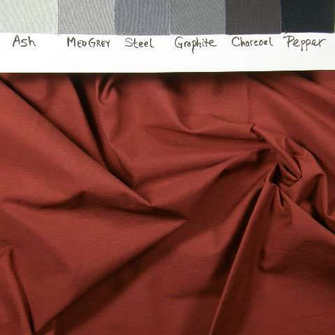 A flat red-brown solid hand-dyed fabric on #419 broadcloth.