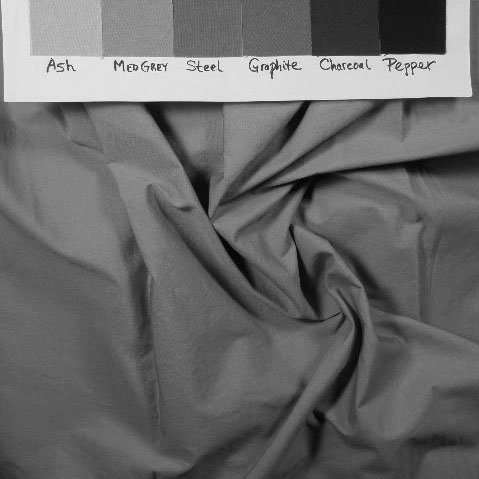 Medium light red-violet fabric in black and white to show value