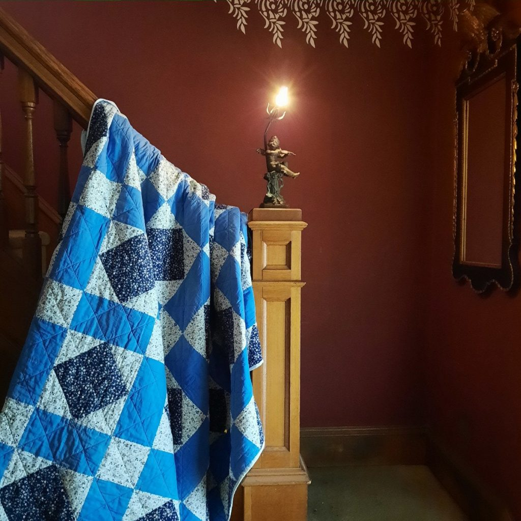 Quilt on the banister
