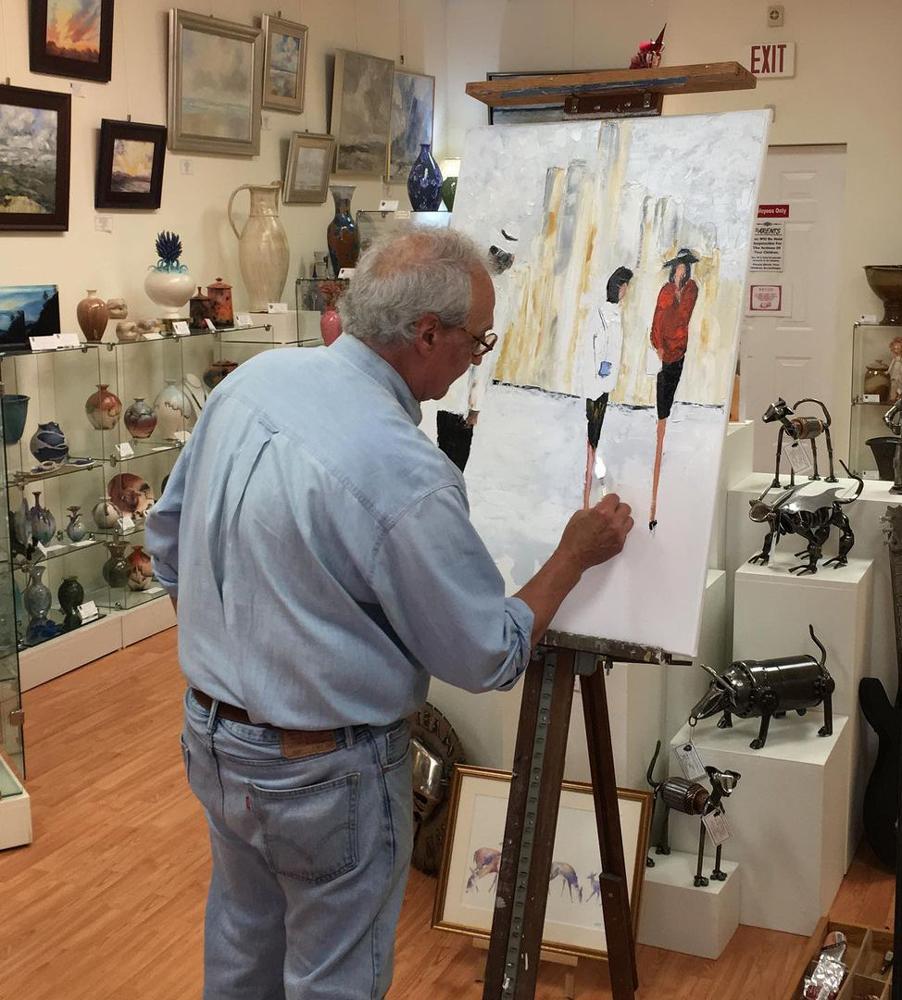 Artist painting onsite at Turning Leaf Gallery in Blue Ridge, GA