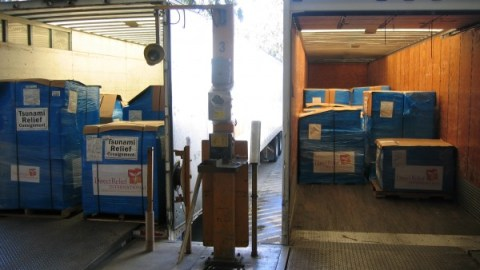 Loading Bay with Trucks Transporting Direct Relief Medical Supplies