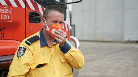 Firefighter Kurt Hill of Albian Park Rural Fire Service loads 15,000 masks on Jan. 16, 2020, in Picton, New South Wales, Australia. The area has been seriously impacted by bushfires and 30 homes have been lost in the surrounding area since Oct. 2019. The masks would go to fire crews and community members still enduring poor air quality. (Lara Cooper/Direct Relief)