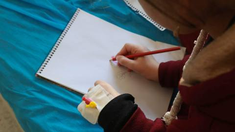 A young patient draws at Hiwa Cancer Hospital, the only specialized cancer hosital in Iraqi Kurdistan, and the second-largest provider of cancer care in all of Iraq. In partnership with Kurdistan Save the Children, a donation of requested chemotherapy medicine from Direct Relief was delivered to the hospital in January 2019. (Photo courtesy of Hiwa Cancer Hospital)