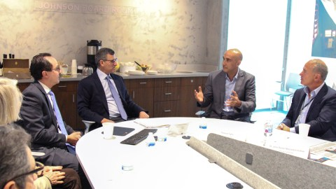 aguay's Minister of Health Dr. Julio Daniel Mazzoleni Insfran meets with Direct Relief boardmembers and Amgen's Eduardo Cetlin at Direct Relief's new distribution center and offices on March 5, 2019. (Lara Cooper/Direct Relief)