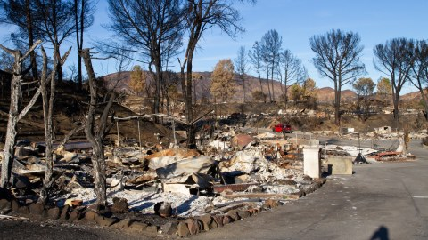 The Woolsey Fire destroyed more than 100 homes in the Seminole Springs Mobile Home Park. Protective gear was delivered Monday to volunteers who are working with residents to sift through the remains of their homes. (Dan Hovey/Direct Relief)