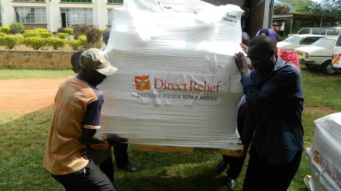 A Fistula Repair Module from Direct Relief is unloaded at the Gynocare Fistula Center in Kisii, Kenya. (Courtesy photo)
