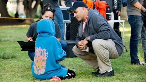 Dr. Jason Prystowsky talks with a patient at Santa Barbara's Alameda Park. (Photo by Mark Semegen for Direct Relief)