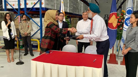 AHA Centre Executive Director Adelina Kamal (center left) and Direct Relief's Executive Vice President and Chief Operating Officer Bhupi Singh formally inaugurate a newly completed warehouse in the Philippines on July 1, 2019. The warehouse, completed with funding from Direct Relief, will expand disaster response in the region. (Direct Relief photo)
