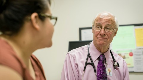 Dr. Fenzi speaks with a patient at Santa Barbara Neighborhood Clinics. (Photo by Andrew Schoneberger for Direct Relief)