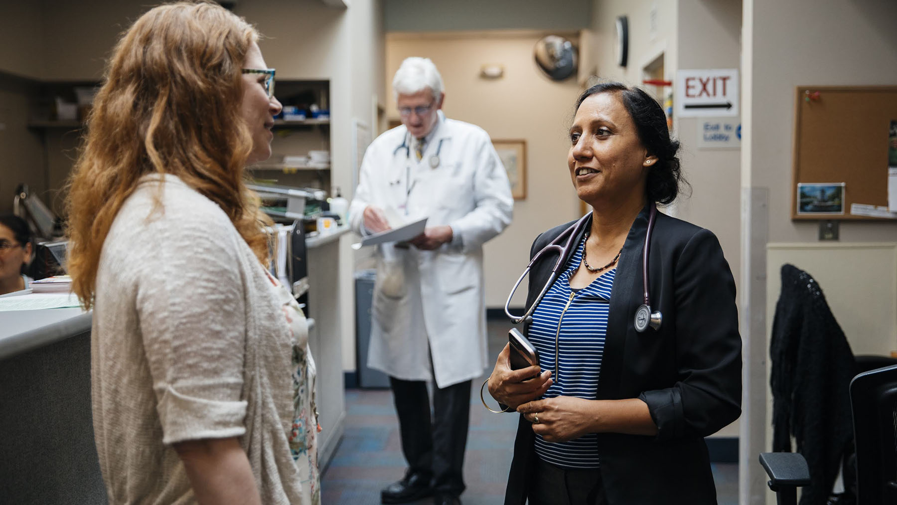 Dr. Roli Dwivedi (right), clinical director, Community University Health Care Center in Minneapolis, speaks with the center's director of pharmacy, Christina Cipolle. The health center works with care teams to treat the whole patient as they work to manage chronic diseases like diabetes. (Photo by Donnie Hedden for Direct Relief)