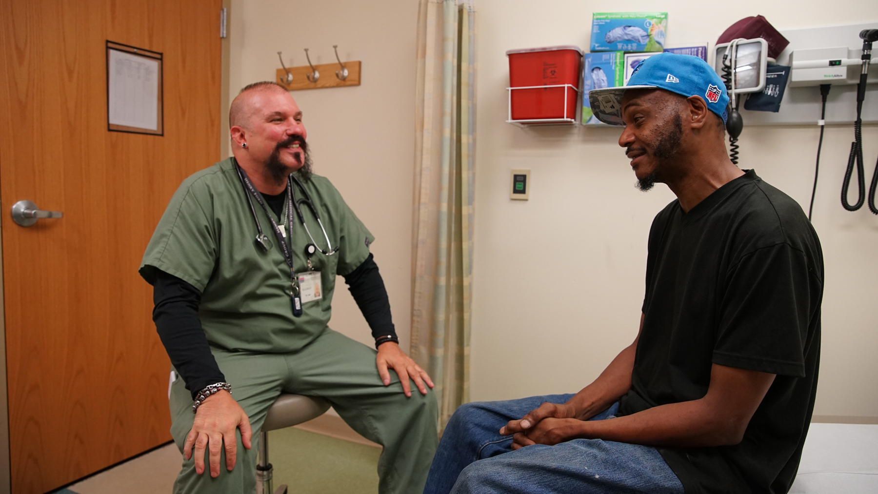 Eric Walker, 48, of Detroit and Dr. Jamie Hall after their appointment at CHASS (Noah Smith/ Direct Relief)