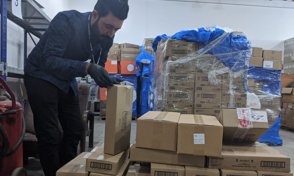 Dr. Lazgeen Jamil unpacking supplies at a Department of Health warehouse in Duhok, in the Kurdistan region of Iraq. ( Photo Courtesy of Culture Shock Productions)