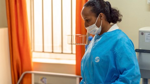 A health worker at Mulago National Referral Hospital talks to a patient's family. (Photo courtesy of Texas Children's Hospital)