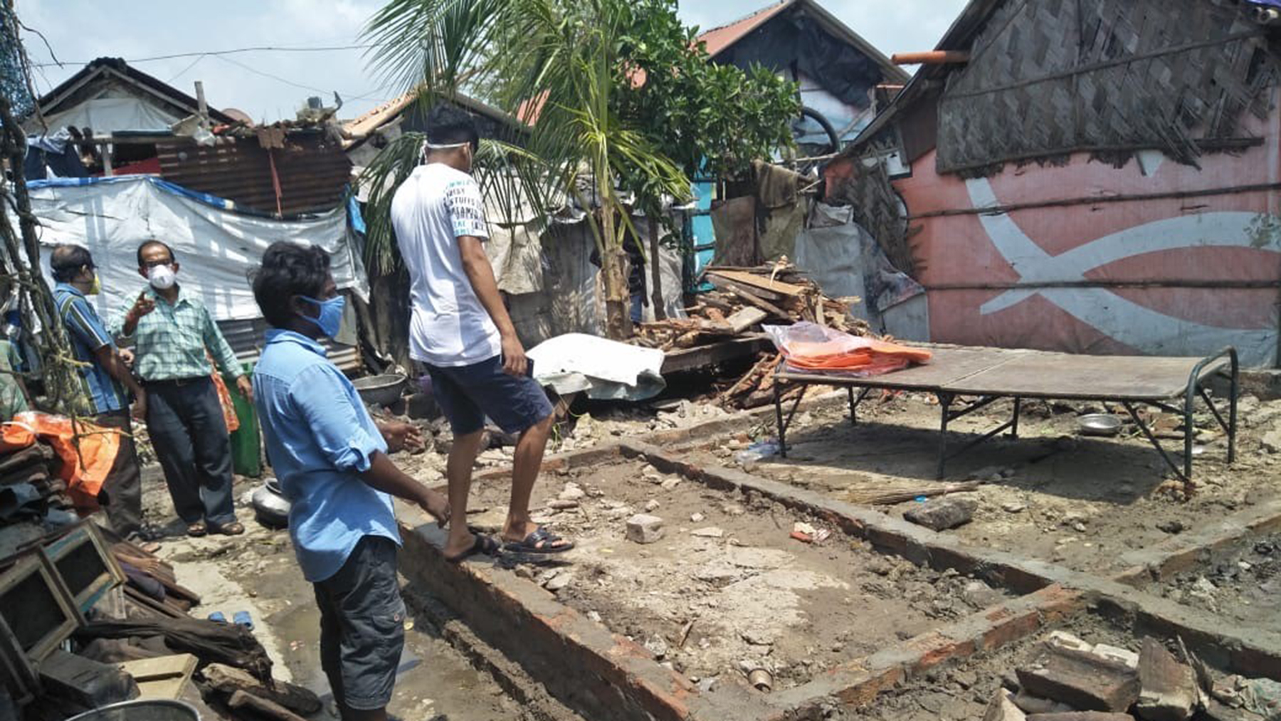 Calcutta Rescue workers examine a damaged structure. (Photo courtesy of Dr. Alakananda Ghosh)