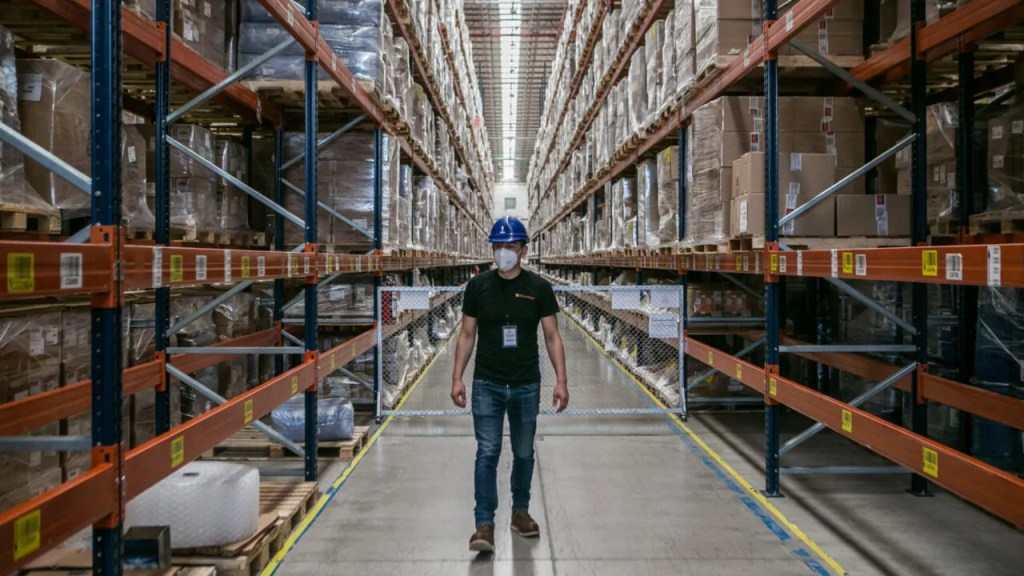 Direct Relief's Eduardo Mendoza surveys boxes of Direct Relief's supplies at a warehouse outside Mexico City. Here, at one of the largest pharmaceutical warehouses in Mexico, Direct Relief's massive shipment of PPE is sorted and prepared for deliveries throughout Mexico City and the neighboring state of Morelos. (Meghan Dhaliwal for Direct Relief)