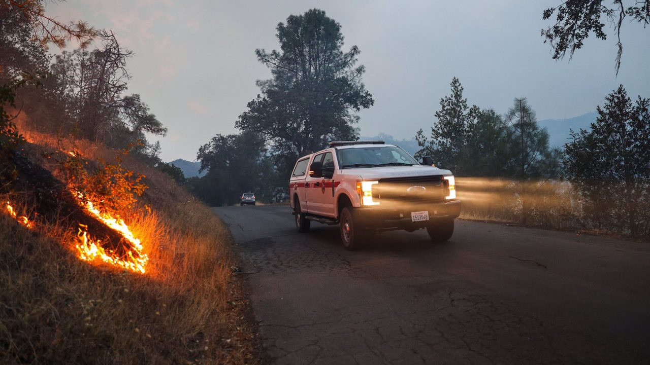 CalFire crews move through active fire zones as the Hennessy Fire burns in Napa County on August 18, 2020. Residents across the state are enduring withering heat and dozens of fires simulatneously. (Photo by Ethan Swope)