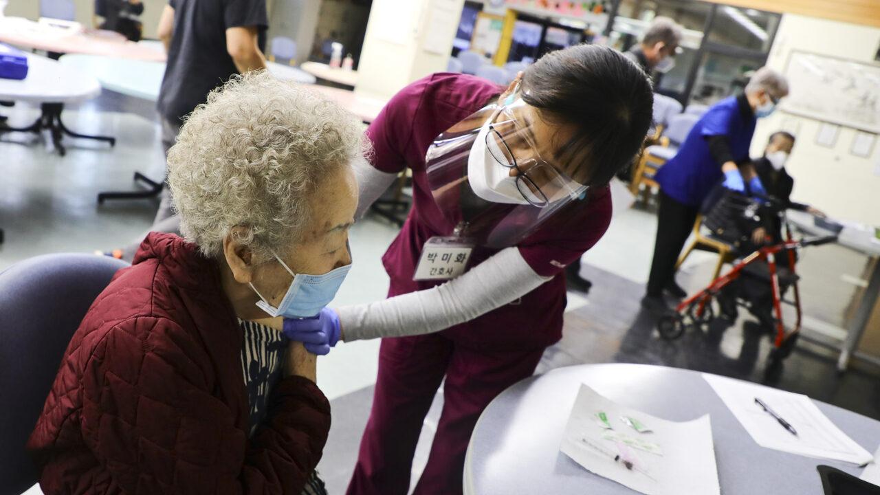 A Kheir Center staff member vaccinates a senior patient. (Photo courtesy of Kheir Center)