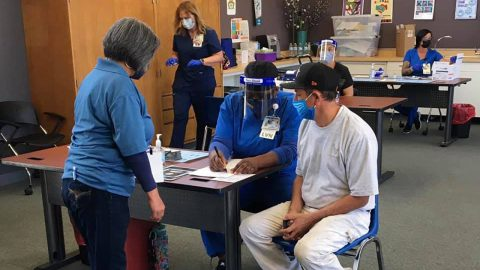 A Covid-19 vaccine clinic at La Familia Counseling Center in Sacramento, California. In addition to mental health services, the clinic provides the community with primary health care and educational resources. (Photo courtesy of LAFCC)