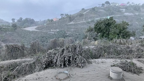 Ash coats a hillside on St. Vincent on April 11, 2021, as the eruption at La Soufriere blanketed communities with debris from the volcano. (Photo by UWI-Seismic Research Centre, Prof. Robertson)