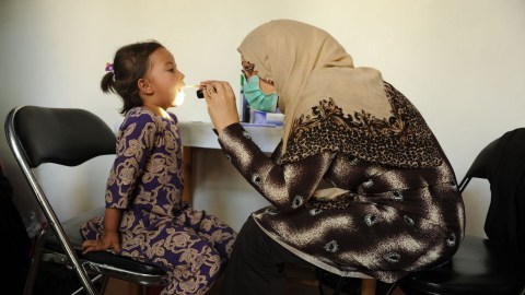 A health worker treats a young patient as part of AMOR Afghanistan's health efforts. Among other health services, the nonprofit provides health education and diabetes awareness throughout the country, and received $413K worth of diabetes medications from Direct Relief over the past week. (Courtesy photo)