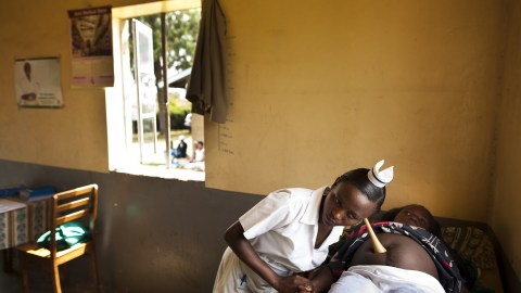 A midwife in Uganda checks a fetal heartbeat during a prenatal visit. This week, Direct Relief and the International Confederation of Midwives launched the Global Midwives' Hub, a resource for data collection and advocacy that aims to increase midwifery globally. (Photo by Trevor Snapp)