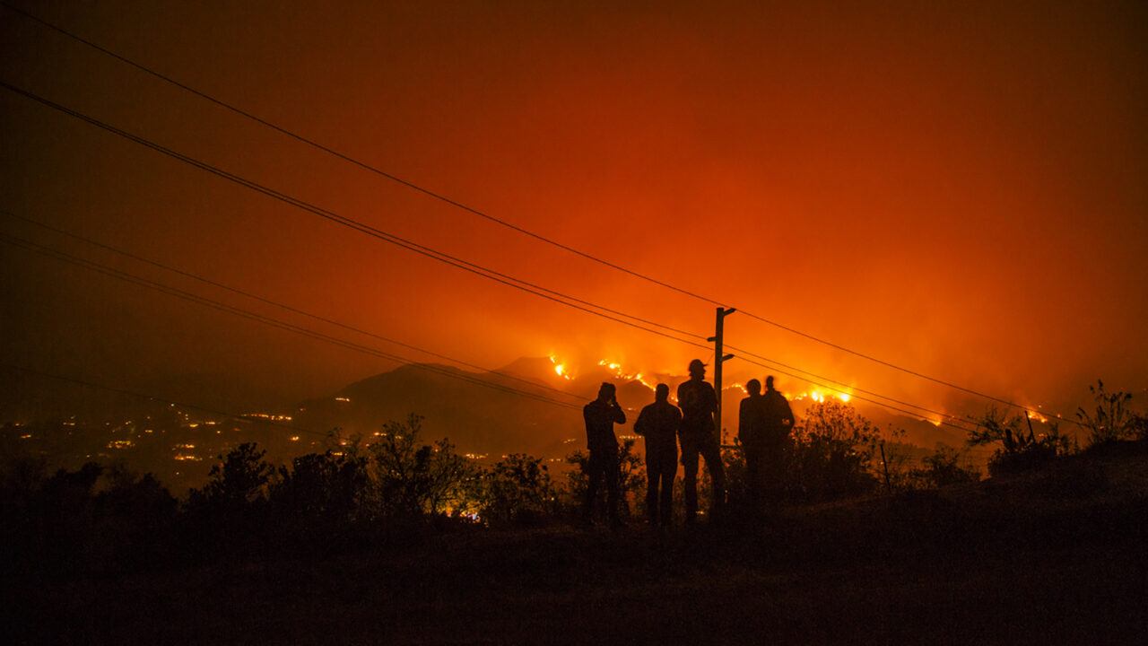 Amid ongoing drought conditions, much of the Western U.S. is at risk of extensive wildfires., Experts in health and emergency response are working to determine how to better to respond to health impacts resulting from wildfires, like the Thomas Fire, pictured here in the hills above Santa Barbara, California, in Dec. 2017. (Photo by Donnie Hedden)