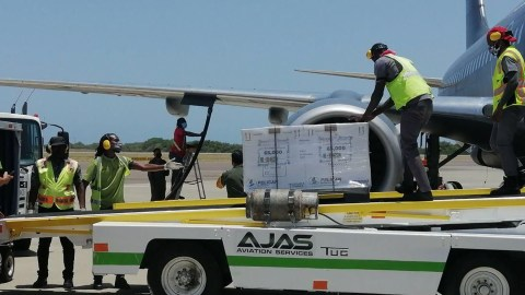 Mexico's Air Force delivers 65,000 AstraZeneca Covid-19 vaccines to Kingston, Jamaica on June 30, 2021. Direct Relief provided cold shippers and logistics and customs expertise for the shipment between the Mexican and Jamaican governments. (Courtesy photo)