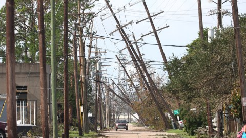 Utility poles lean over a street following Hurricane Ida on August 31, 2021, in Houma, Louisiana, after Ida made landfall as a Category 4 storm. (Photo by Scott Olson/Getty Images)