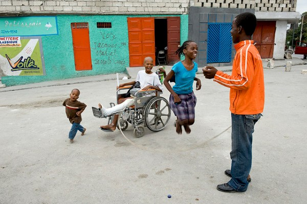 Children jump rope and laugh, with boy who was injured in quake. Photo courtesy of Hope for Haiti Foundation.