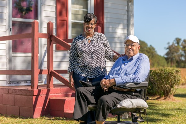 Willie Riddick (right) has been able to manage his health better with the remote monitoring program. BD Photo.