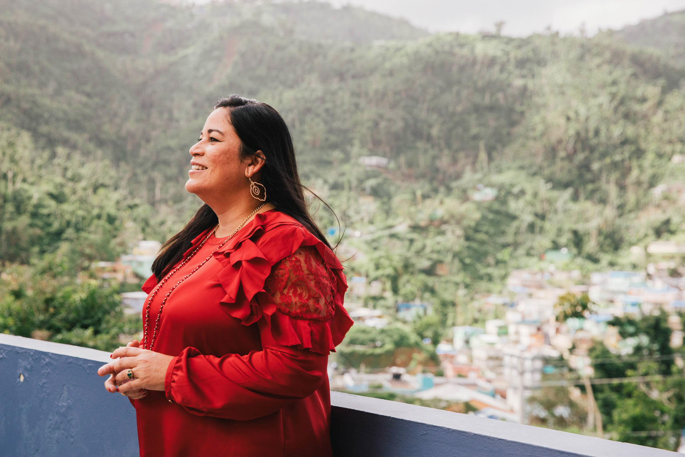 "Gloria del C. Amador Fernández, executive director of Salud Integral de la Montana Health Center, overlooks the mountain community of Naranjito on Dec. 17, 2017. During Hurricane Maria's high winds, the health center stayed open. ""We were the only ones providing care on the mountain,"" she said. (Photo by Donnie Hedden for Direct Relief)"