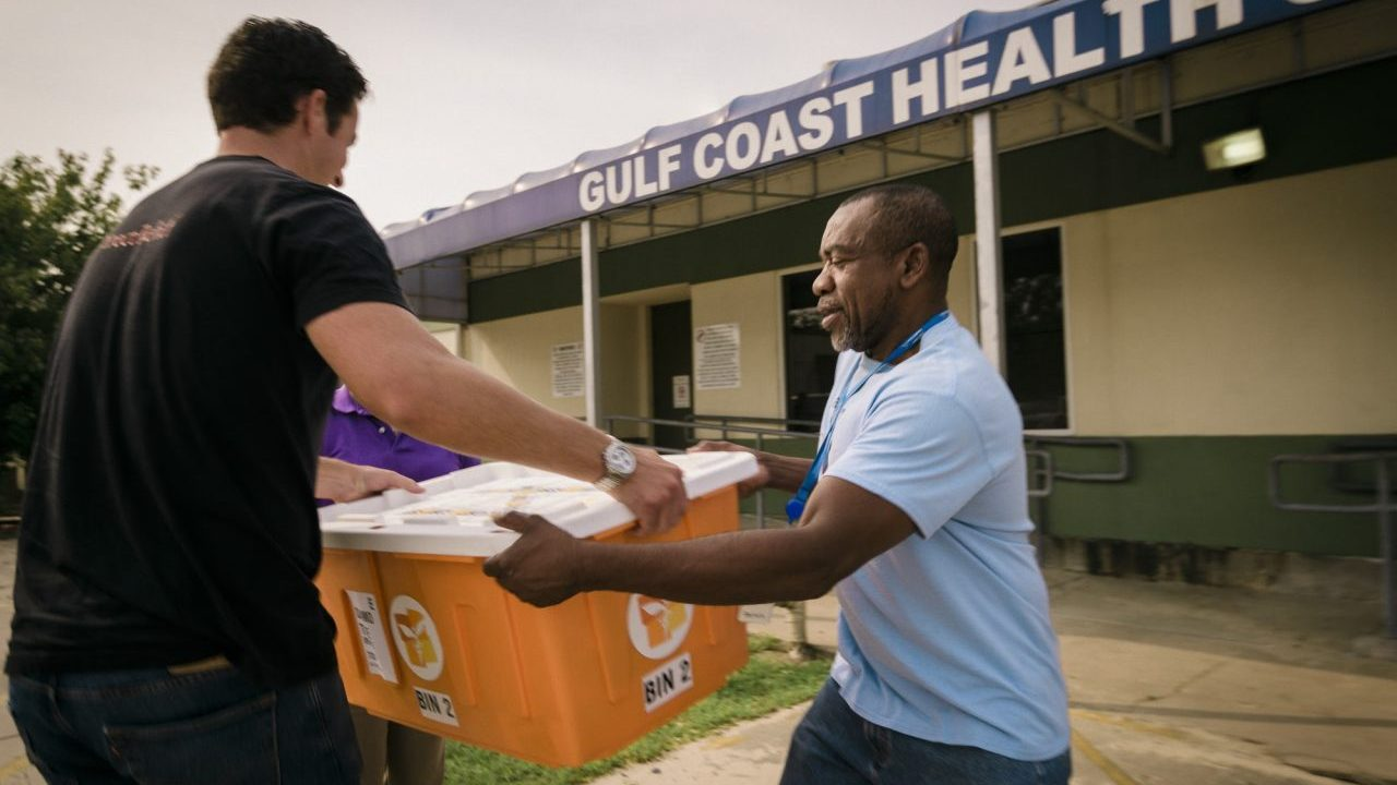 Emergency medicines were handed off to staff at the Gulf Coast Health Center in Port Arthur in the days after Hurricane Harvey made landfall. (Photo by Bimarian Films for Direct Relief)