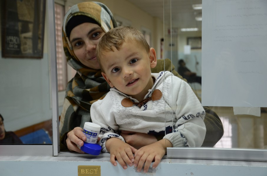 Living with financial constraints, Yusra can lean on the Hebron Charitable Medical Center for medical help. Yusra is happy that her youngest son Muhannad hasn't caught her flu. (Photo courtesy of Anera)