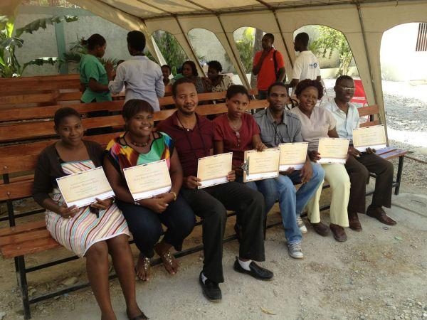Haitian providers receiving their certificates for cervical cancer screening.