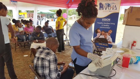 A support group at Cornwall Regional Hospital in Kingston, Jamaica, where blood glucose tests were administered to children. The test's reagents were delivered by Direct Relief in conjunction with the Jamaica Diabetes Association and the Life for a Child Program. (Photo courtesy of the Jamaica Diabetes Association)