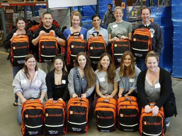 Nursing students from Santa Barbara City College were among the volunteers who helped organize the 400 backpacks at Direct Relief. Photo by Mark Semegen.