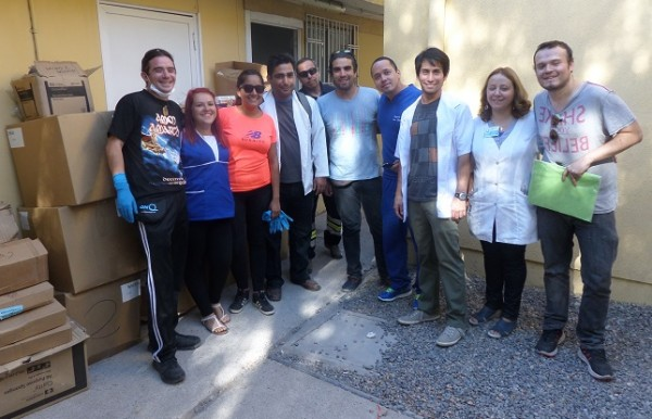 The FEDES team smiles after unloading a donation of medical supplies from Direct Relief.