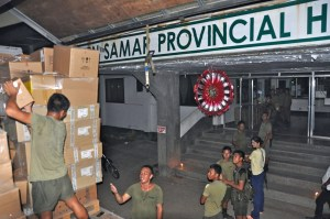 Unloading at night with Phil Military- Eastern Samar Provincial Hospital PAINT