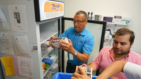 Health ProMed Nursing Director Angel Rodriguez, Ruben Bras of the Puerto Rico Primary Care Association and other ProMed staffers quickly load Humulin R insulin into cold storage at the ProMed San Juan clinic. Humulin R is used in emergency situations to stabilize a patient's blood sugar. The medicines have become critical since the hurricane, with many patients battling stress and limited access to nutritious food. (Lara Cooper/Direct Relief)