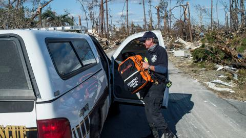 Mexico Beach Fire Chief Donald 'Sandy' Walker carries a loaded Direct Relief supply backpack to his cruiser on Sunday, October 14, 2018.