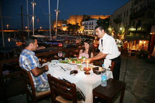 Couple enjoying dinner in Kyrenia Harbour