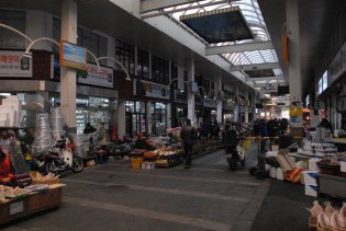 Inside the market. Note the person driving toward the crowd.